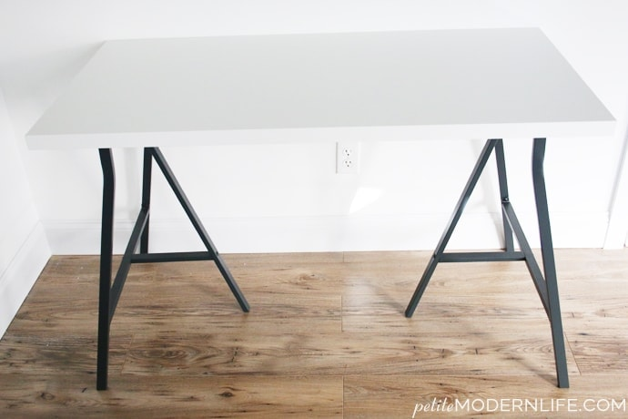 Build your own modern + sleek desk for as low as $26 (like this pretty one with trestle legs + white table top!)