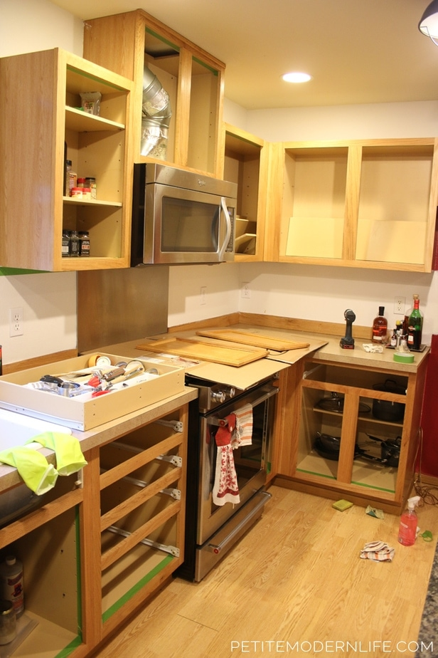 See what we learned of cleaning, priming and painting our kitchen cabinets in Part 2 of our Kitchen Makeover   Petite Modern Life