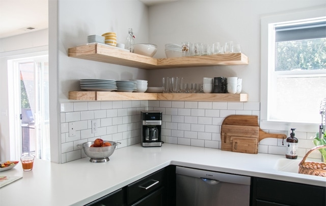DIY Custom Floating Shelves with a natural finish and heavy weight bearing design.