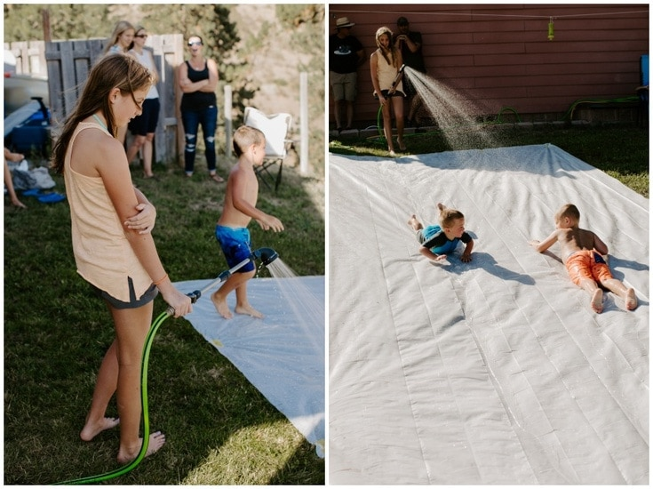 DIY plastic sheeting slip and slide with kids sliding