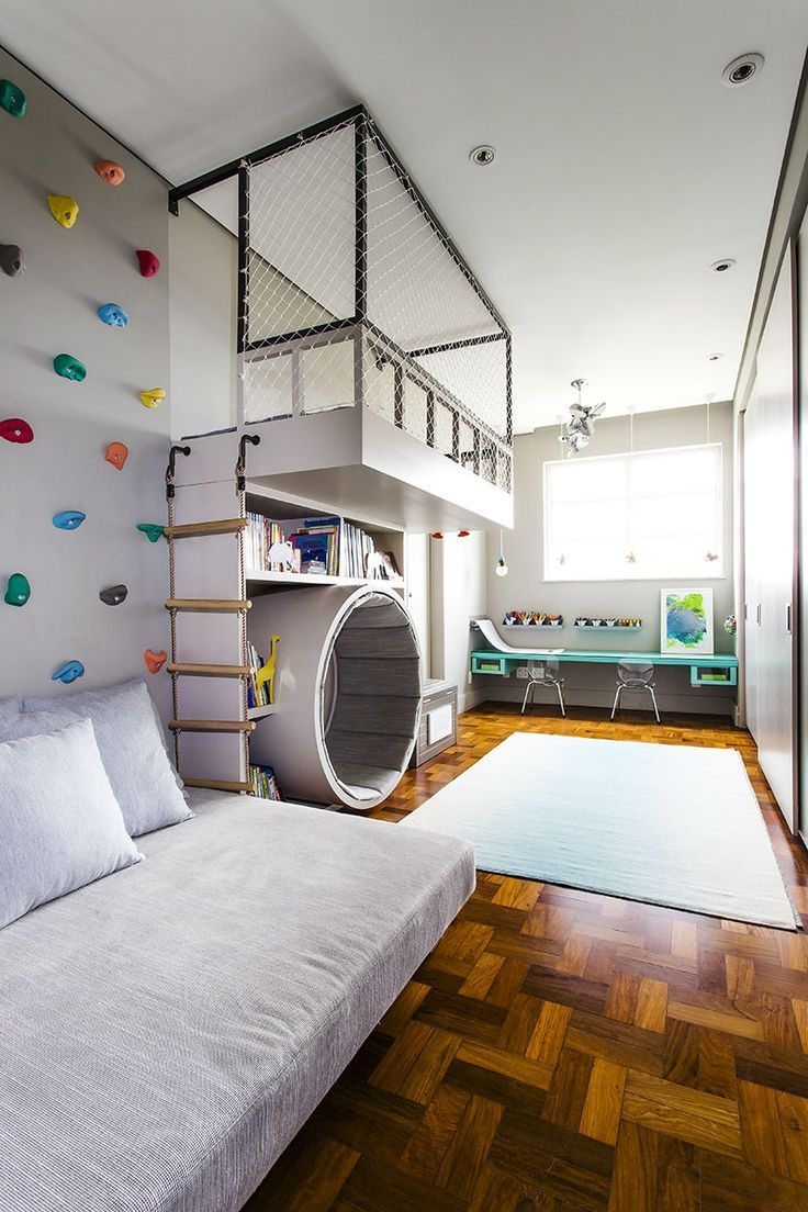 indoor playground with climbing wall, ladder, soft tub