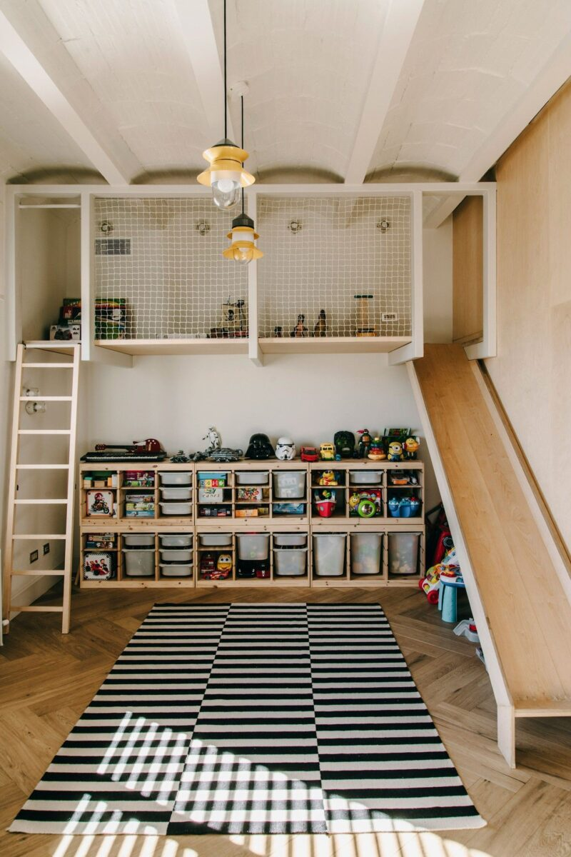 minimal indoor playground with ladder, netted loft, and slide