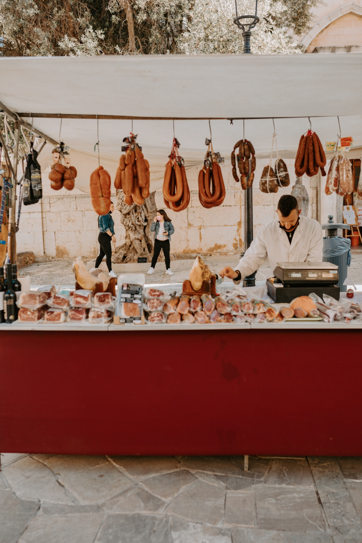 Meat vendor at the Inca Market in Mallorca Spain